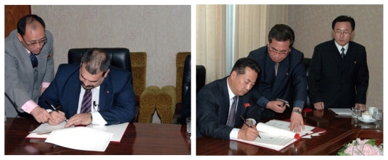 Cuban Ambassador to the DPRK Germán Hermín Ferras Álvarez (L) and DPRK Minister of Foreign Trade Ri Ryong Nam (R) sign 2013 protocol agreements on trade, economic science and technology cooperation in Pyongyang on 12 December 2012 (Photos: KCNA)