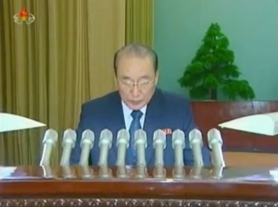 Yang Hyong Sop reads the report at the national meeting of judicial officers (Photo: KCNA/KCTV screengrab)
