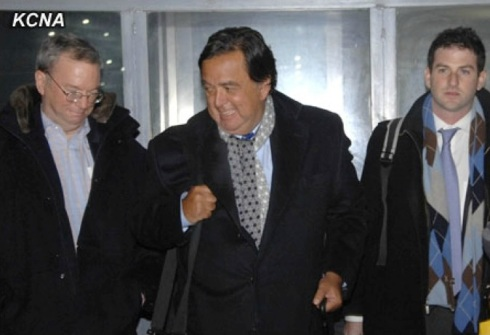 Former New Mexico Governor Bill Richardson (C) smiles after arriving in Pyongyang on 7 January 2013.  Also in this image is Google Executive Chairman Eric Schmidt (L) (Photo: KCNA)
