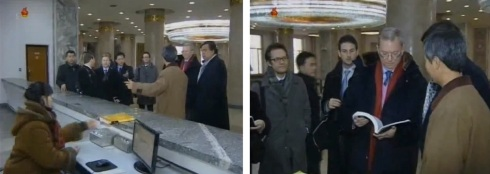 The Richardson-Schmidt delegation visit an information desk at the Grand People's Study House (Photos: KCTV screengrabs)