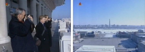 Google Executive Chairman Eric Schmidt (L) takes a photograph of the Chuch'e Tower (R) from the balcony of the Grand People's Study House in Pyongyang (Photos: KCTV screengrabs)