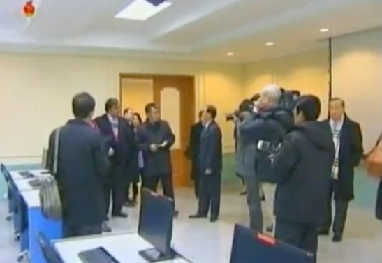 Bill Richardson, Eric Schmidt and members of their delegation tour a classroom at the E-Library at Kim Il Sung University (Photo: KCTV screengrab)