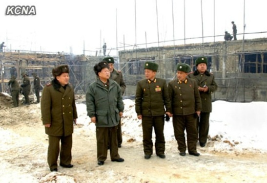 KPA General Political Department Director Gen. Choe Ryong Hae (2nd L) inspects construction work at the Turf Institute of the State Academy of Sciences (Photo: KCNA)