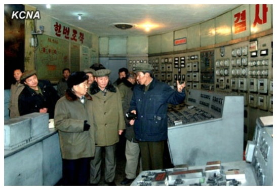 Choe Yong Rim (L) is briefed about the Pukch'ang Thermal Power Complex in South P'yo'ngan Province (Photo: KCNA)