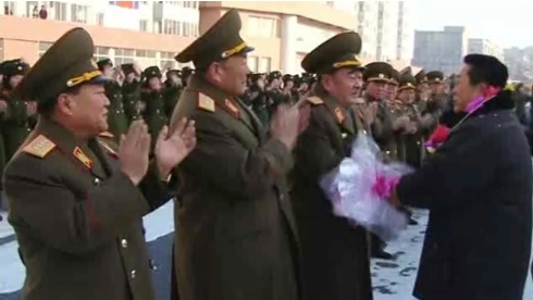 Minister of the People's Armed Forces, Gen. Kim Kyok Sik (3rd L) shakes hands with a Korean Committee for Space Technology manager on 4 January 2013.  Also seen in attendance are Gen. Choe Ryong Hae (L) and Gen. Hyon Yong Chol (2nd L) (Photo: KCTV screengrab)