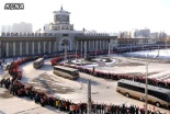 Buses carrying personnel who contributed to the 12 December 2012 U'nha-3 rocket launch ride past Pyongyang Central Railway Station prior to departing the city on 4 January 2013 (Photo: KCNA)