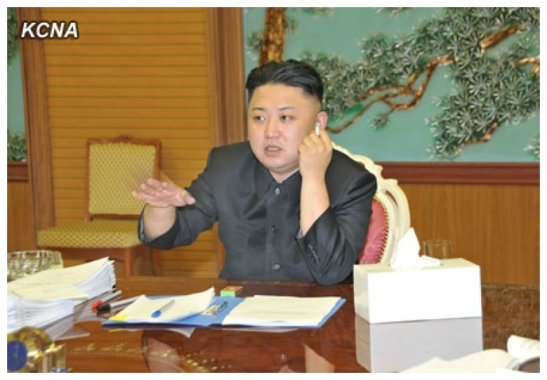 Kim Jong Un smokes a cigarette and speaks during a meeting of foreign policy and security officials that he convened (Photo: KCNA)