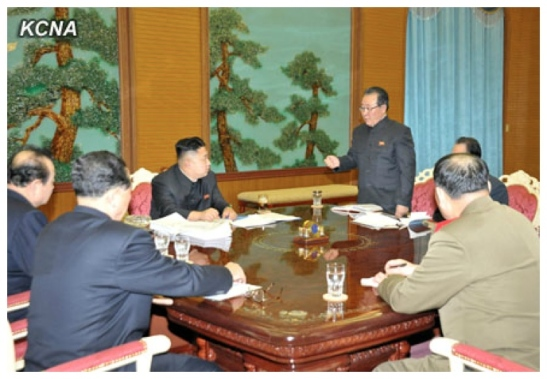 DPRK 1st Vice Foreign Minister Kim Kye Gwan (standing, R) delivers a report to Kim Jong Un during a meeting of security and foreign policy officials (Photo: KCNA)