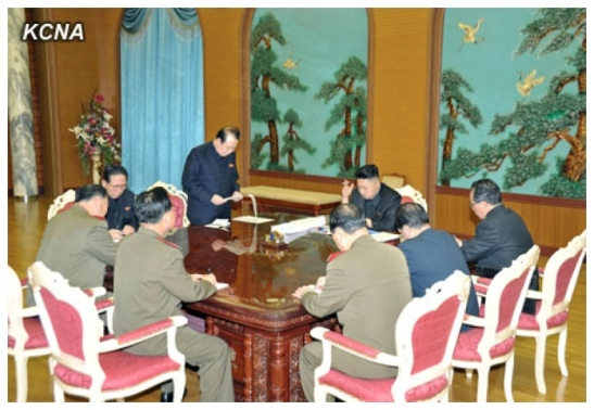 KWP Secretary Pak To Chun (L, standing) delivers a report during a meeting of foreign policy and security officials convened by Kim Jong Un (Photo: KCNA)