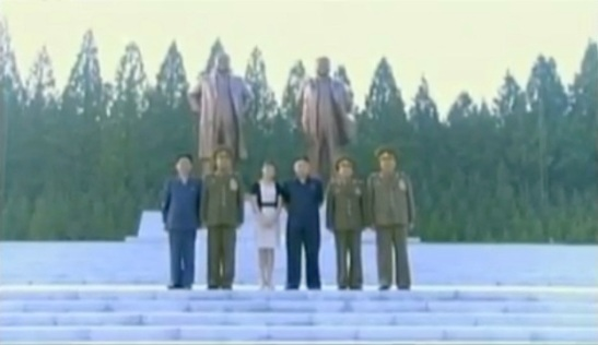 Commemorative photo taken in front of the KIS-KJI statues at the Ministry of the People's Armed Forces.  In this image (L-R): Hwang Pyong So, VMar Kim Jong Gak, Ri Sol Ju, Kim Jong Un, Gen. Choe Ryong Hae and Gen. Hyon Yong Chol (Photo: KCTV screengrab)