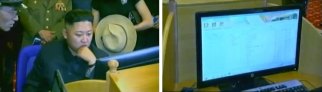 Kim Jong Un (L) at a computer workstation at the KPA Exhibition of Arms and Equipment E-Library (Photos: KCTV screengrab)