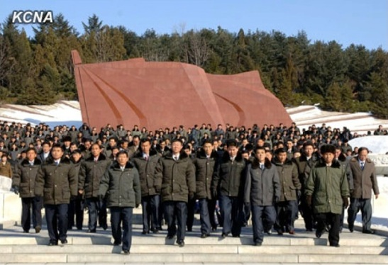 Party cell secretaries solemnly walk though the Revolutionary Martyrs' Cemetery on 26 January 2013 (Photo: KCNA)