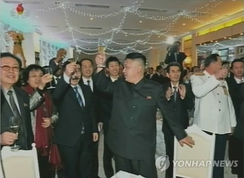 Jang Song Taek (L) attends a New Year's reception in Pyongyang on 1 January 2013 with Kim Jong Un (4th L) and the PRC Ambassador to the DPRK (3rd L) (Photo: KCNA-Yonhap)