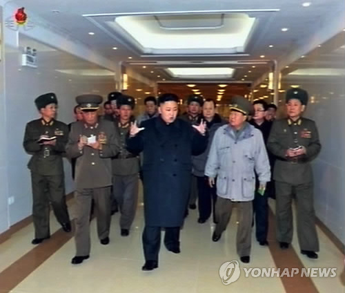 Kim Jong Un (3rd L) talks to Gen. Choe Ryong Hae (2nd R) during a tour of the construction of Taesongsan General Hospital (Photo: KCNA-Yonhap)