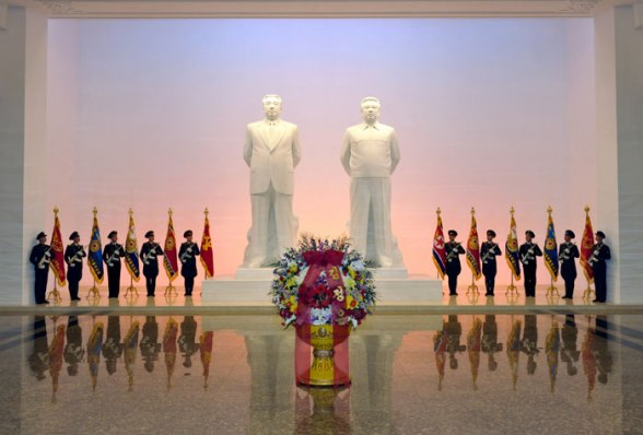 A floral basket from Kim Jong Un in front of statues of his grandfather Kim Il Sung and father Kim Jong Il at Ku'msusan in Pyongyang on 16 February 2013 (Photo: Rodong Sinmun)