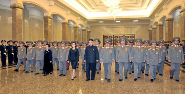 Kim Jong Un (C) pays his respects to statues of his father Kim Jong Il and his grandfather Kim Il Sung at Kumsusan in Pyongyang on 16 February 2013.  (Photo: Rodong Sinmun)