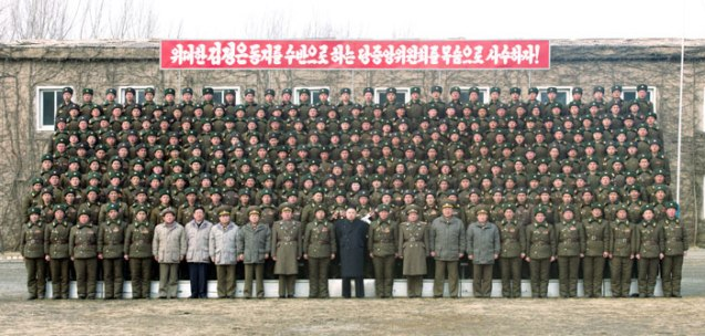Kim Jong Un poses with service members and officers of the 4th Battalion of KPA Unit #323 (Photo: Rodong Sinmun)