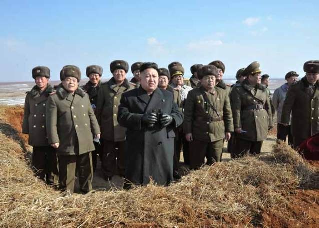 Kim Jong Un (4th L) holding binoculars during his field inspection of KPA Large Combined Unit #630 (Photo: Rodong Sinmun)