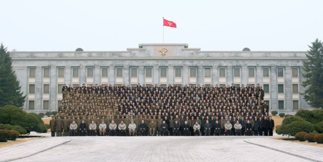 Kim Jong Un poses for a commemorative photograph with personnel involved in the DPRK's nuclear test held on 12 February 2013.  The photo was taken in front of the KWP Central Committee #1 Office Building in central Pyongyang. (Photo: Rodong Sinmun)