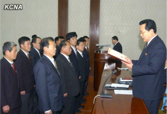 DPRK Vice Premier Kim Yong Jin (R) reads a citation at the 2013 ceremony for the 16 February Science and Technology Prize at the People's Palace of Culture in Pyongyang on 6 February 2013 (Photo: KCNA)
