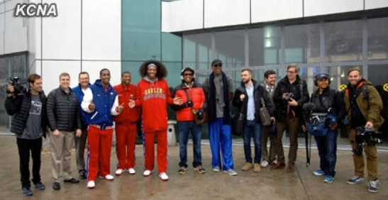 Dennis Rodman (6th R), members of the Harlem Globetrotters and a film crew from VICE Media Group poses for a commemorative photograph at Pyongyang Sunan Airport after their arrival on 26 February 2013 (Photo: KCNA)