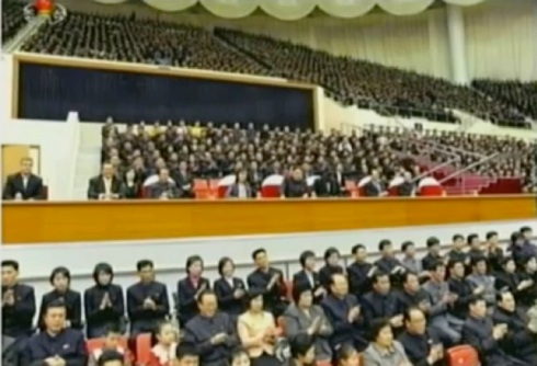 Kim Jong Un (4th R) and Dennis Rodman (3rd R) watch the Harlem Globetrotters demonstrate various techniques and tricks.  Also in attendance are Jang Song Taek (3rd L) and Ri Sol Ju (4th L) (Photo: KCTV screengrab)
