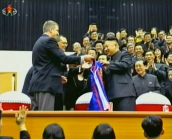 Kim Jong Un receives a Harlem Globetrotters uniform after the game.  Also seen in attendance is KJU's uncle Jang Song Taek (R), Vice Chairman of the National Defense Commission and Chairman of the DPRK Physical Culture and Sports Commission (Photo: KCTV screengrab)