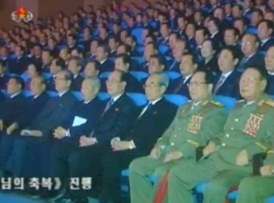 DPRK central leadership attend schoolchildren's Lunar New Year's concert at Mangyo'ngdae Schoolchildren's Palace on 10 February 2013.  In this image (L-R) are Kang Sok Ju; Yang Hyong Sop; Choe Tae Bok; Choe Yong Rim; Kim Yong Nam; Kim Ki Nam; VMar Kim Yong Chun; VMar Ri Yong Mu (Photo: KCTV screengrab)