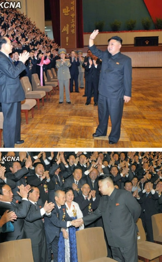 Kim Jong Un greets party cell secretaries during a commemorative photo session with party cell secretaries' meeting participants (Photos: KCNA)