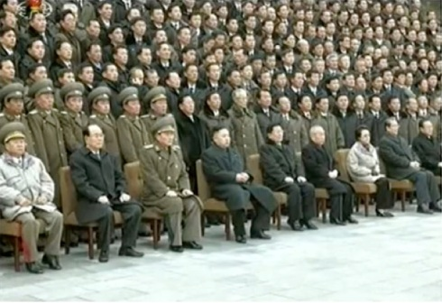 Kim Jong Un (4th L) sits for a commemorative photograph with personnel involved in the 12 February 2013 nuclear test (Photo: KCTV screengrab)