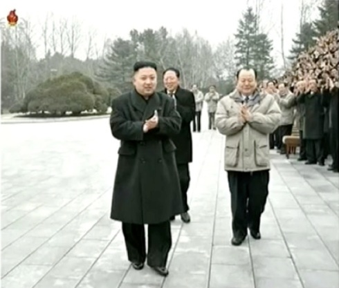 Kim Jong Un applauds during after a commemorative photo session with nuclear test personnel.  Seen in attendance is Hong Sung Mu (behind KJU 2nd R), Deputy Director of the KWP Machine-Building Industry Department  and Pak To Chun (R), KWP Secretary for Machine-Building (Military) Industry (Photo: KCTV screngrab)
