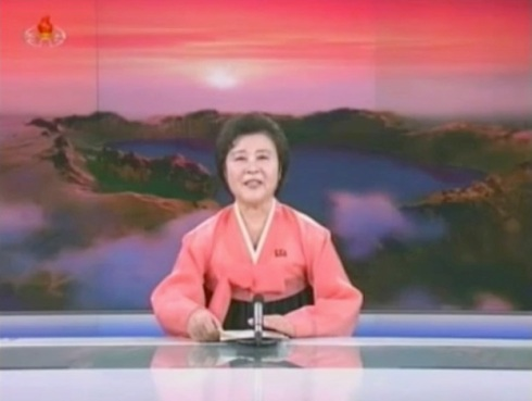 KCTV anchorwoman Ri Chun Hui broadcastingDPRK state media's account of KJU's attendance at a basketball game and a banquet hosted by the DPRK Olympic Committee, attended by Dennis Rodman, members of the Harlem Globetrotters and other members of the US delegation (Photo: KCTV screengrab)