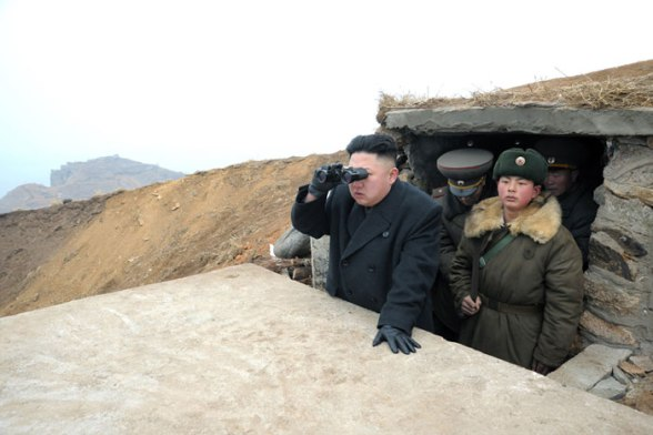 Kim Jong Un looks at a South Korean island from a military observation post on a DPRK islet in the West Sea (Yellow Sea) (Photo: Rodong Sinmun)