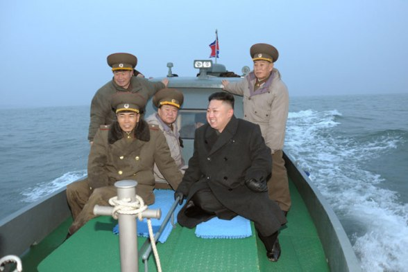 Kim Jong Un (2nd R) rides on a small vessel in the West Sea during his inspection of Jangjae ad Mu Islets.  Also seen on the boat are VMar Choe Ryong Hae (3rd L) and Gen. Kim Yong Chol (R) (Photo: Rodong Sinmun)