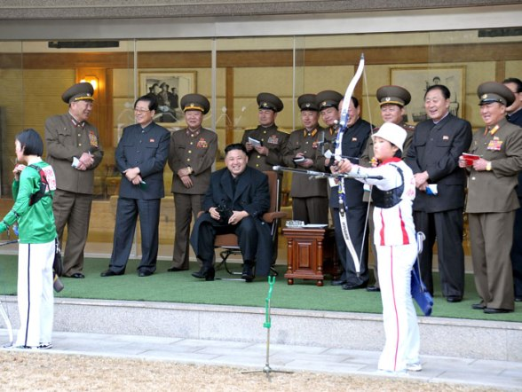 Kim Jong Un (4th L, seated) watches a woman's archery competition between archers of the 25 April Sports Team and the Amnokgang Sports Team.  Also in attendance are Gen. Hyon Yong Chol (L), Jang Song Taek (2nd L), VMar Choe Ryong Hae (3rd L) (Photo: Rodong Sinmun)