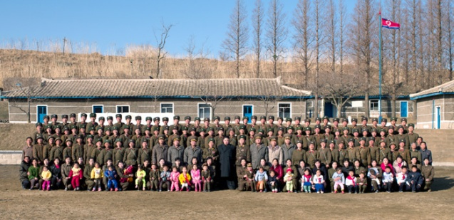 Kim Jong Un poses for a commemorative photograph with service members, officers and their family members during a field inspection of Wolnae Islet's defense unit on 11 March 2013 (Photo: Rodong Sinmun)