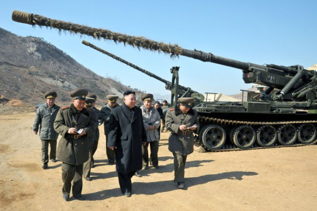 Kim Jong Un (2nd L) views a piece of long-range artillery piece during an inspection of a unit subordinate to the KPA Unit #641 (Photo: Rodong Sinmun)