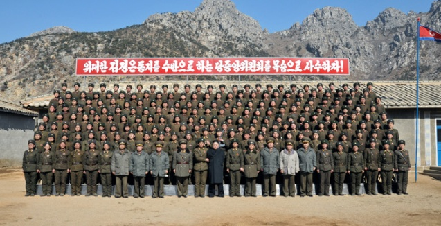 Kim Jong Un (front row, 12th L) poses for a commemorative photograph with service members and officers of the long-range artillery unit subordinate to KPA Unit #641 (Photo: Rodong Sinmun)