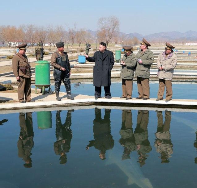 Kim Jong Un (4th R) views a fish breeding pool at the Ryongjong Fish Farm.  Also seen in this image are VMar  Choe Ryong Hae (3rd R), Gen. Kim Kyok Sik (2nd R) and Gen. Kim Yong Chol (R) (Photo: Rodong Sinmun)