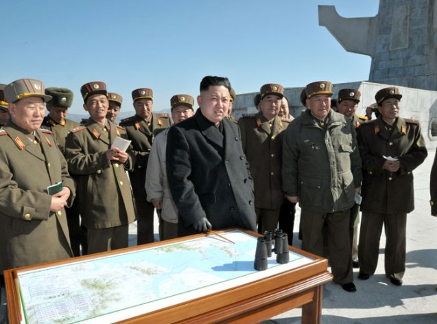 Kim Jong Un (foreground, 4th R) observes live fire artillery exercises in the West (Yellow Sea).  Also seen in attendance is Gen. Kim Yong Chol (L), Gen. Hyon Yong Chol (2nd R) and Gen. Kim Kyok Sik (3rd R) (Photo: Rodong Sinmun)