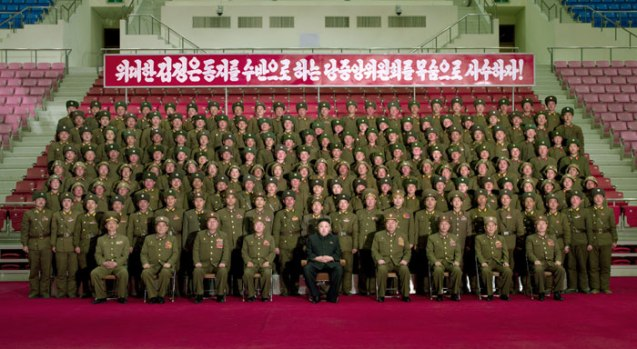 Kim Jong Un (C, seated) poses for a commemorative photograph with KPA service members and officers from island defense units who participated in live fire exercises in the West (Yellow) Sea on 13 March 2013 (Photo: Rodong Sinmun)