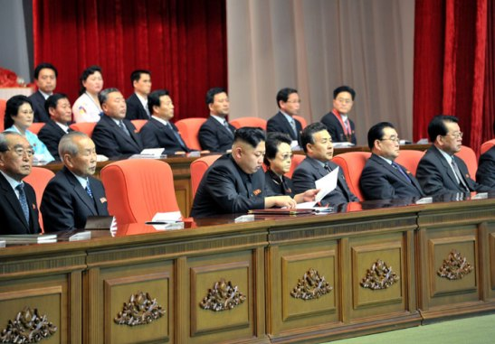 Kim Jong Un (3rd L) sits on the platform (rostrum) during the national meeting of light industry workers in Pyongyang on 18 March 2013.  Also on the platform are Kim Ki Nam (L), Choe Yong Rim (2nd L), Kim Kyong Hui (4th L) and Tae Jong Su (5th L) (Photo: Rodong Sinmun)