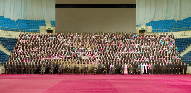 Commemorative photograph of Kim Jong Un and members of the central leadership with participants in a national meeting of light industry workers in Pyongyang on 19 March 2013 (Photo: Rodong Sinmun)