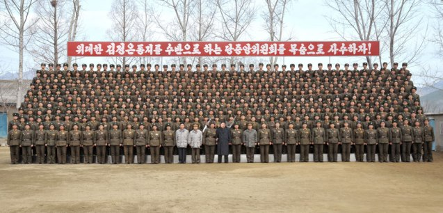 Kim Jong Un poses for commemorative photograph with service members and officers of the command element of KPA Unit #1973