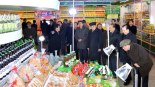 Senior members of the central leadership tour an exhibition of light industry goods in Pyongyang.  Among the officials in this image are: Choe Tae Bok (5th R), Kim Yong Nam (4th R) Yang Hyong Sop (3rd R) and Pak To Chun (2nd R) (Photo: Rodong Sinmun)