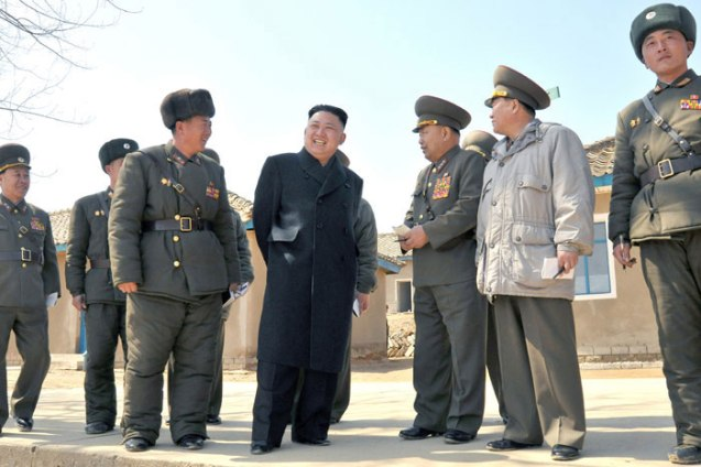 Kim Jong Un (2nd L) smiles during a tour the 2nd Battalion of KPA Unit #1973 on 23 March 2013 (Photo: Rodong Sinmun)