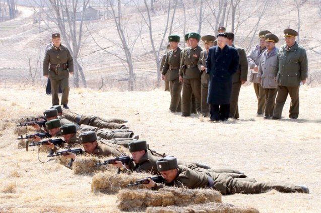 Kim Jong Un observes SOF personnel serving in the 2nd Battalion of KPA Unit #1973 participating in small arms drills on 23 March 2013 (Photo: Rodong Sinmun)