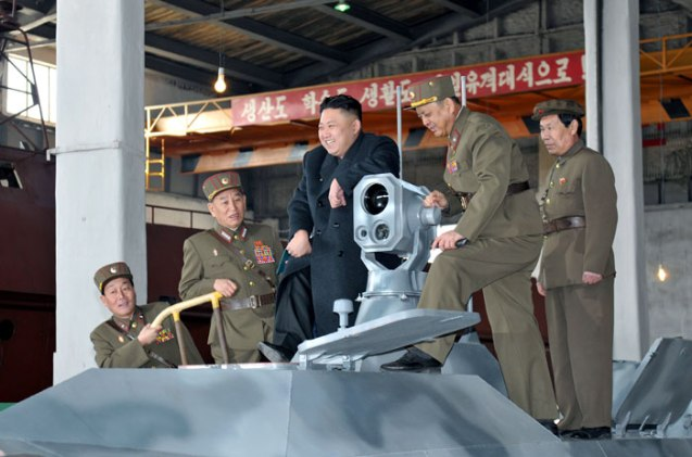 Kim Jong Un stands on a combat vehicle during an inspection of KPA Unit #1501 on 24 March 2013.  Also in attendance is Gen. Kim Yong Chol (2nd L), Chief of the Reconnaissance General Bureau and spokesman of the KPA Supreme Command (Photo: Rodong Sinmun)