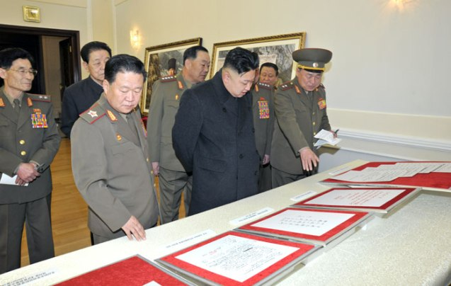 Kim Jong Un (2nd L, front row) examines documents earmarked for display at the reconstructed Victorious Fatherland War (Korean War) Museum on 24 March 2013.  Also in attendance is VMar Choe Ryong Hae (L, front) and Kim Kyong  Ok (2nd L, rear) (Photo: Rodong Sinmun)