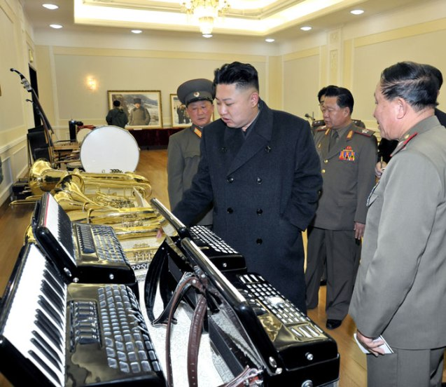 Kim Jong Un examines accordions and brass instruments, produced by KPA factories and units (Photo: Rodong Sinmun)